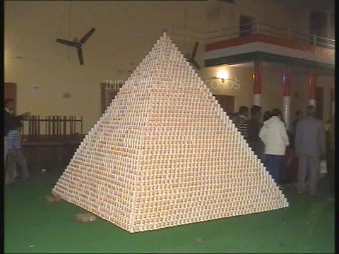Another kind of coffee pyramid scheme. Largest pyramid of coffee cups from the India Book of Records.